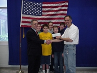 Presenting a check to the Make a Wish Foundation.