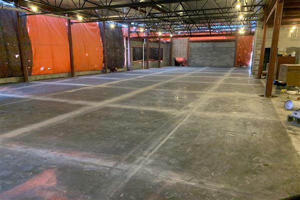 The concrete flooring has been poured in the cafetorium