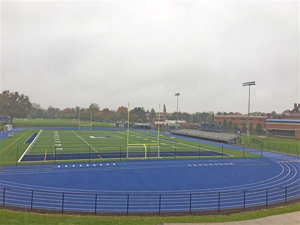 The District installed a new turf field and track surface. The football end zones and track are blue.