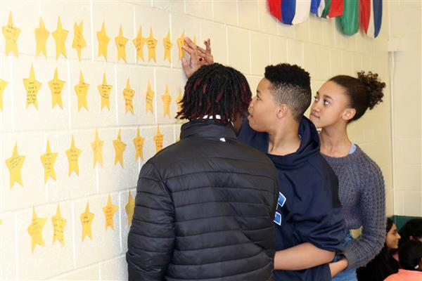 Putting up stars on the Wall of Kindness