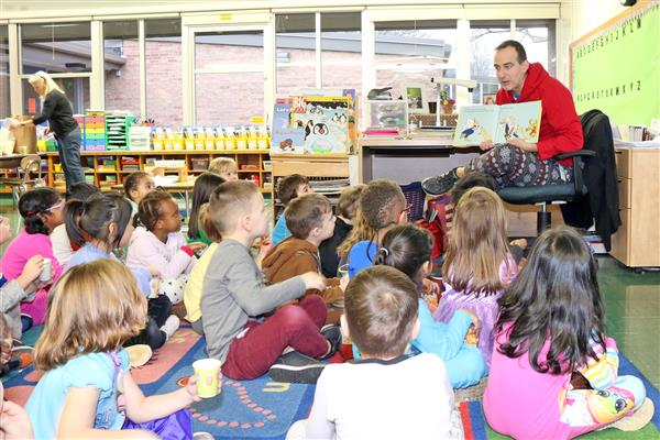 Mr. Tappon reads to classes.